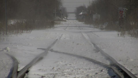 Winter scenic of cars driving over train tracks (High Definition) Footage