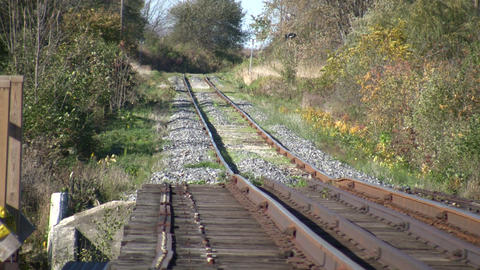 Railway tracks head off into the sunny distance (High... Stock Video Footage