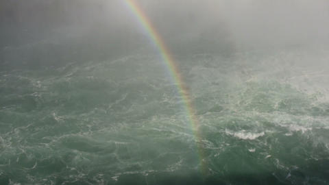 Rainbow is visible amidst the whitewater rapids (High... Stock Video Footage