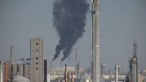 Black fumes spill out of large chimneys at Houston Refinery Footage