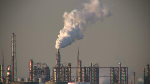 Fumes billow out of large chimney at Houston BP Refinery Footage