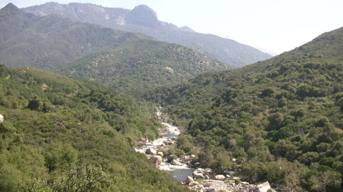 Kaweah River flows downstream through the rocks, creating... Stock Video Footage