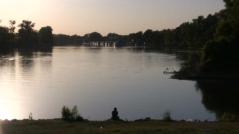 Shot of the calm Sacramento River at sunset Stock Video Footage