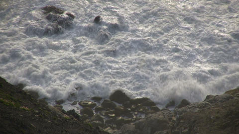 Rough ocean waves crash against the rocky San Francisco shoreline Footage