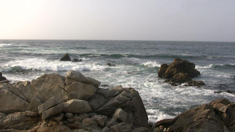 Ocean waves crash against the Californian rocky outcrops Live Action