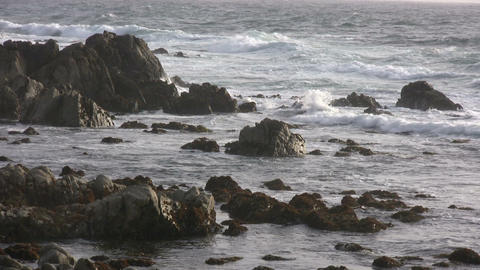Rough ocean waves crash against the rocky California... Stock Video Footage