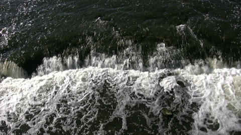 Closeup of foamy and turbulent water from waterfall (High... Stock Video Footage
