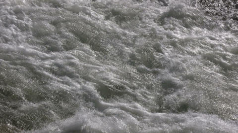 Closeup of the rough waters of the Kaweah River Stock Video Footage