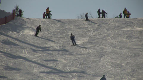 Winter scenic of people skiing down a hill (High Definition) Stock Video Footage