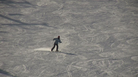 Winter scenic of girl skiing down a hill (High Definition) Stock Video Footage