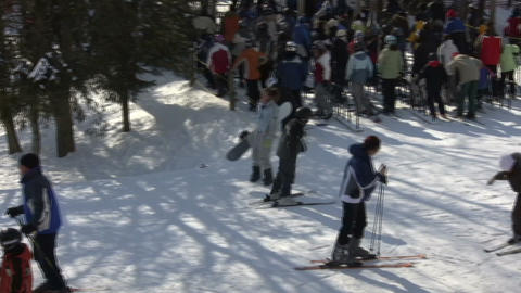 Winter scenic of people at a ski resort (High Definition) Stock Video Footage