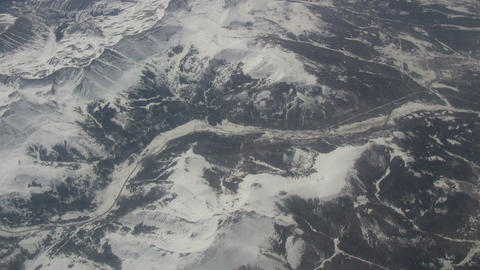 Aerial shot of a snowy mountain landscape Stock Video Footage