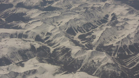 Aerial shot of a snowy mountain landscape Footage