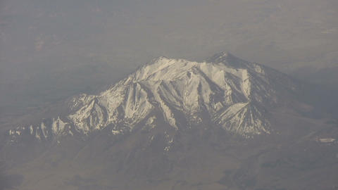 Aerial shot of a snowy mountain Stock Video Footage