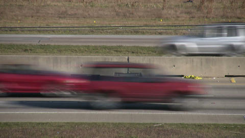 Side shot of fast moving traffic on a sunny day Stock Video Footage