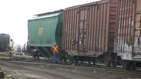 Railway worker unhitching a freight car (High Definition) Footage