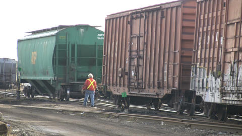 Railway worker unhitching a freight car (High Definition) Stock Video Footage