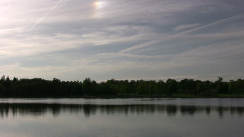 Serene scene of quiet lake, reflecting the treeline (High Definition) Footage