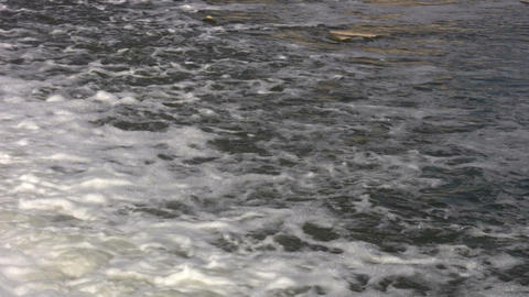 Closeup of river's flowing surface as it ripples (High Definition) Footage