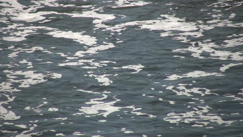 River's surface is foamy as it flows (High Definition) Stock Video Footage