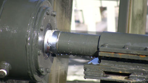 Closeup of a metal shaft as it turns (High Definition) Footage