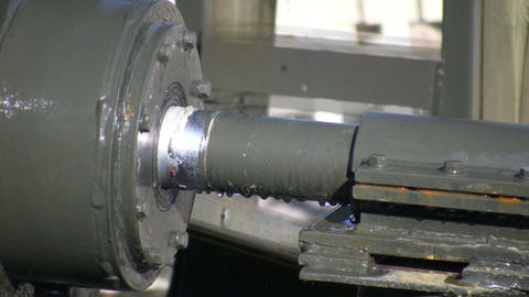Closeup of a metal shaft as it turns (High Definition) Stock Video Footage