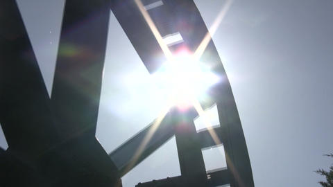 Sunlight shines through gaps of spinning water wheel... Stock Video Footage