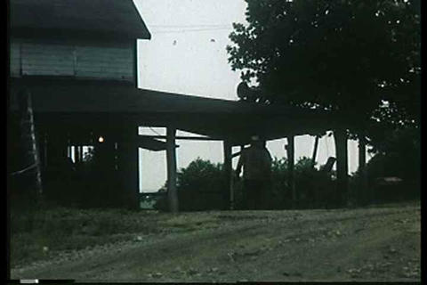 Men gather for a picnic in this 1949 home movie Footage