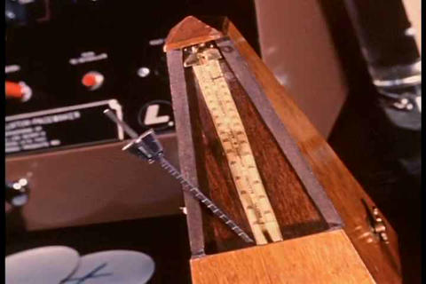 A metronome ticks away a rhythm Footage