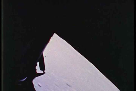 The Apollo 11 landing craft approaches the moon's  Footage
