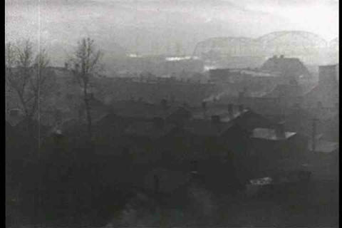 Pollution rings an industrial town in the 1930s Footage