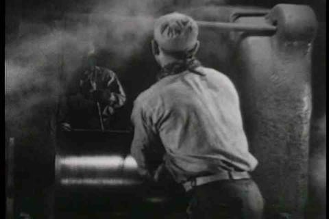 A musical montage of steel factory workers on the  Live Action