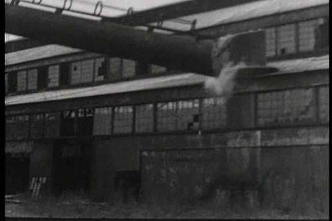 Workers look on mournfully as their factory is tor Footage