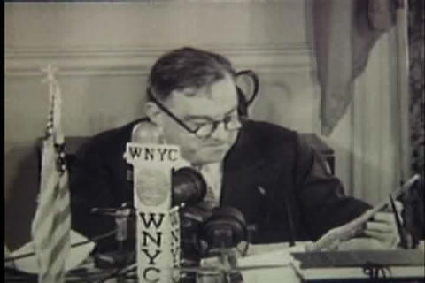Mayor LaGuardia reads the comics over the radio Footage