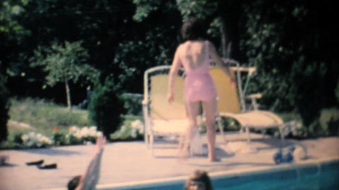 Attractive Lady In Pink Bathing Suit By Pool 1967 Footage