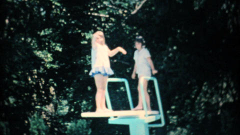 Girls On Diving Board At Swimming Pool 1967 8mm stock footage
