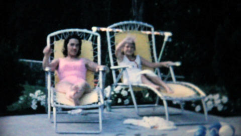 Mother And Daughter By Swimming Pool 1967 Vintage stock footage