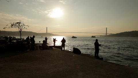 Sunset Time Lapse Fishing Silhouettes On Bosporus stock footage