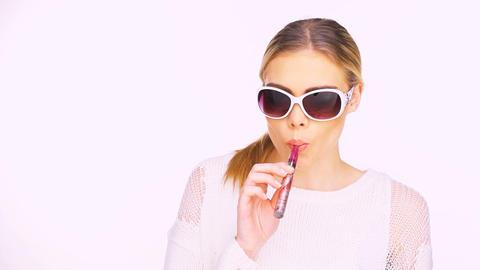 Woman smoking an e-cigarette Live Action
