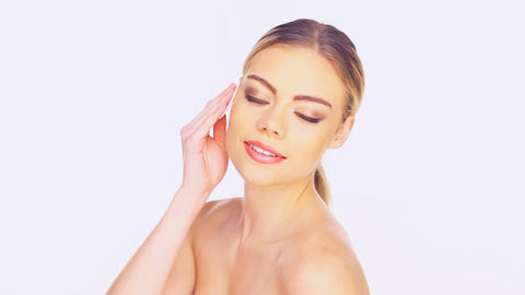 Beauty portrait of a woman cleansing her face Stock Video Footage