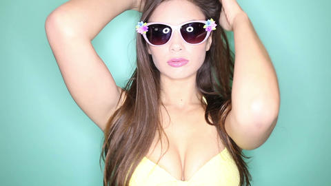 Brunette woman with sunglasses Footage