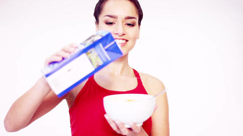 Healthy young woman preparing breakfast Footage