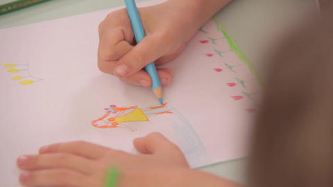 Sequence: Childern Drawing With Coloured Pencils stock footage