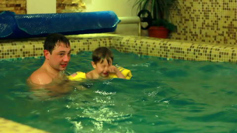 Father with Sons in Pool Footage