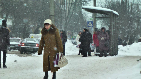 Pedestrians On Street In Snow stock footage