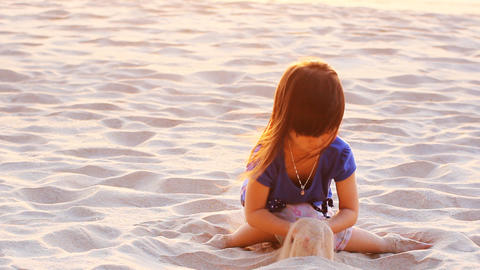 Girl playing sand Footage