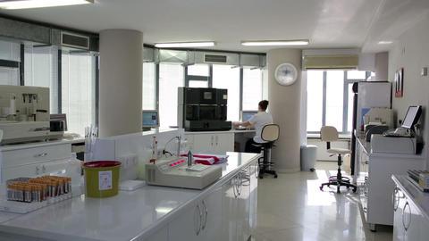 Female scientist working in laboratory Footage