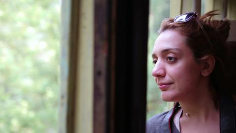 Girl peeking out of train Footage