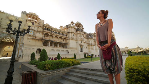 Female tourist at Udaipur Palace Footage