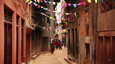 People walking along narrow lane, Kathmandu, Nepal Footage